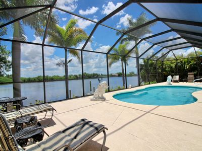 Photo for Romantic home with beautiful lake view, heated south facing pool & large lanai