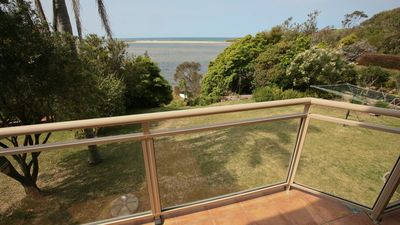 Photo for Lake Front Getaway: Generous home with spectacular lake & ocean views, 10 min to Bermagui - Lak25