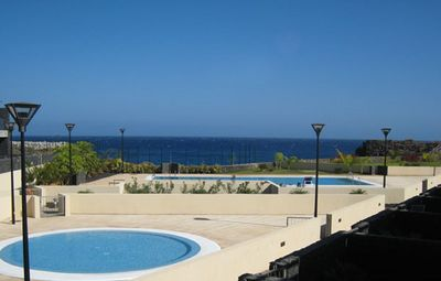 Photo for Oceanfront townhouse 2 bed 2 bath, private terrace, communal garden, shared pool