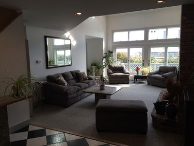 Sunken Living room from foyer entrance - new furnishings - cathedral ceilings