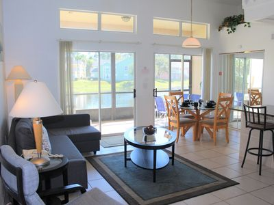 Photo for Spacious 2 bed 2 bath townhome with private screened porch and water views at gated community Mango Key near Disney, Orlando, Florida