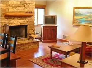 Living Room, Cathedral Ceiling, stacked stone fireplace, Barry's oil painting
