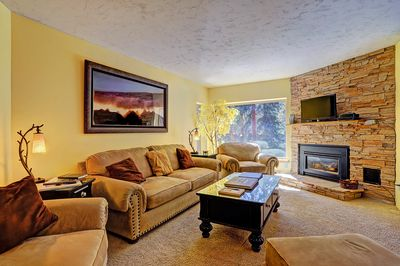 Living room features gas fireplace and flat screen TV