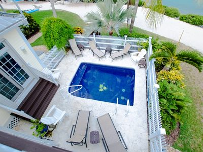 Photo for 5004 Sunset Village with Private Pool, Sunning Beach Access and Breathtaking Water-view