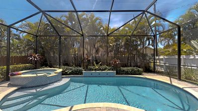 Photo for Two Master Bedrooms! Less than 1 Mile to the beach with heated pool and spa