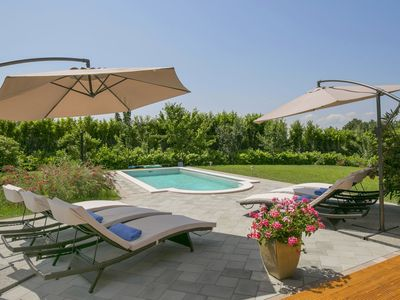 Photo for This 4-bedroom villa for up to 9 guests is located in Labin and has a private swimming pool, air-con