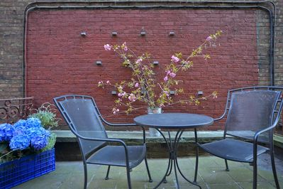 Private terrace with wrought iron table and chairs - view of Hudson River & Park