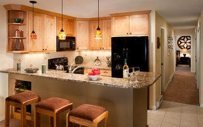 Prepare meals in the fully equipped kitchen and enjoy them together at the dining table or breakfast bar.