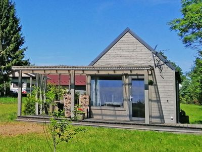 Photo for A new, cozy cottage in a seaside village. Large garden, playground.