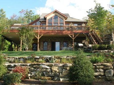 Large deck, covered parking, Jacuzzi, stone firepit and viewside to waterfall