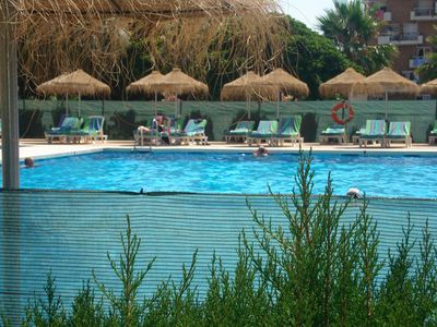 Photo for Air-Conditioned Apartment Close to Beach with Balcony, Pool, Garden & Wi-Fi
