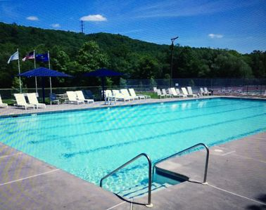 Photo for sleeps 10 with large outdoor area w/firepit resort amenities close to activities