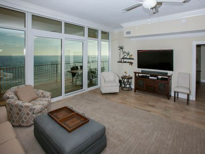 "Living room with 65"" curved TV and Gulf View"