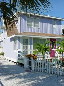 Photo for Charming cottage, steps to the beach.  Across from John's Pass