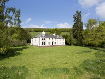 Photo for MOSSFENNAN HOUSE, Broughton - sleeps 8 with vast gardens, Wi-Fi and open fire