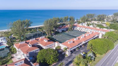 Photo for Private Sugar White Sand Beach. Resort Style Pools. Har-Tru Tennis Courts.