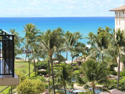 Steps to the beach with ocean views!  Spacious 3 bed/3 bath condo + free parking