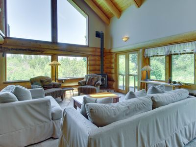 Photo for Gorgeous log cabin w/ private hot tub & pond on five acres of land.