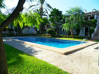 Photo for Ground floor apartment with pool, 250m from the beach and 50m from shops