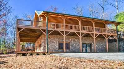 Paved driveway, entry door, & covered decks on both levels