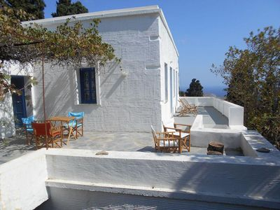 Photo for A 200 year old  farmhouse in a natural garden, view of the sea and Andros town