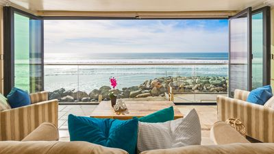 Photo for Beachfront Home with a Rooftop Deck and Spa.