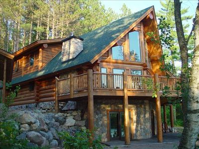 Custom Log Home with large decks and screen porch.  Walk-out lower level.