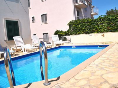 Photo for Swimming Pool Apt, Great Views from Balcony, 800m to beach, Quiet Neighbourhood