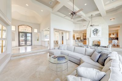 """Living Room - Kick back on a large sectional sofa and watch a movie screening on the 75"""" TV."""