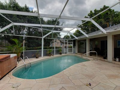 Photo for Waterfront home w/ private pool, hot tub, & dock. Close to beach!