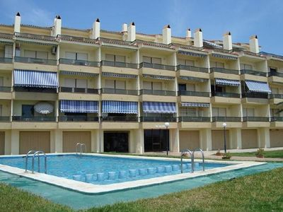 Photo for Apartment 1st line sand beach, swimming pool, terrace with sea view