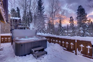 Large deck off kitchen with Jacuzzi tub featuring multiple pro-jets.