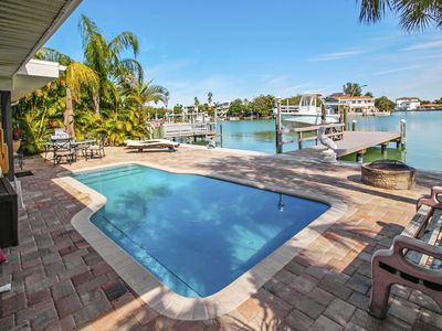 Photo for Manatee Home - Water front pool home walking distance from the Beach!