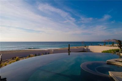 The ocean is only steps away from the infinity pool at Villa Delfines