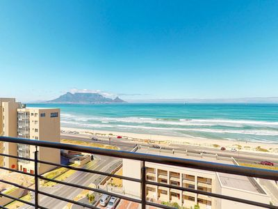 Photo for Ocean view condo with private balcony - walk to the beach!