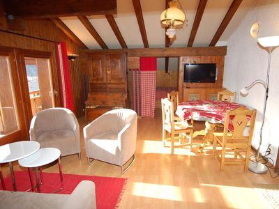 Photo for Charming 2 1/2 rooms, wooded attic on the 4th floor. Located in the center, shops are near and a bus