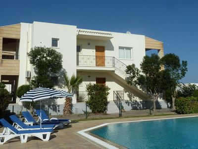 Photo for Delightful Ground Floor Apartment next to Large Pool, Free Internet & Sea-views