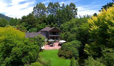 Photo for Centennial House Taupo Luxury Boutique Lodge, stunning gardens & water features