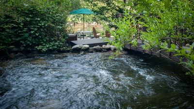 A flume (river) ends at our property and splits to create the two waterfalls