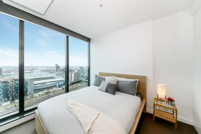 A bedroom with a queen sized bed & a stunning view.