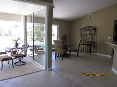 Picture from inside the livingroom, looking onto lanai (screened in patio)