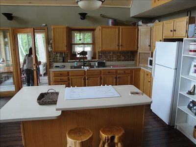 Kitchen w/ snack bar and wheelchair height eating area