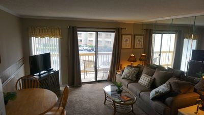 Cozy Living Area with Flat Screen TV/New Couch and Carpeting