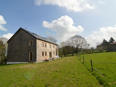 Photo for Spacious and sleek eco cottage in the green pastures of the Ardennes
