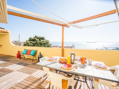 Photo for Spectacular terrace (70m2) view of Tagus