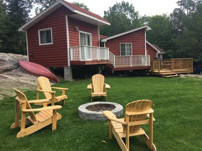 fire pit area with Adirondack chairs