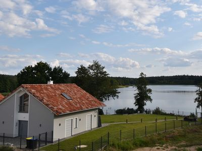 Photo for Luxury lake residence with sauna, fireplace, private lake access -25% - Ferienhaus Rohrdommel 2