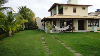 Photo for Cozy House in Guarajuba 4/4 with Swimming Pool, 200m from the Beach, in condominium.