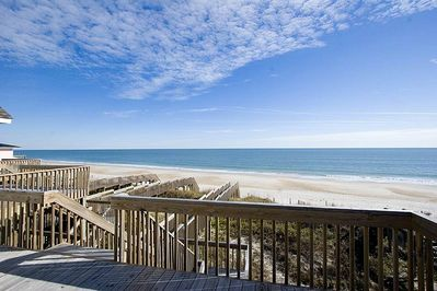 Panoramic views of the wide beach, blue skies, and beautiful ocean.