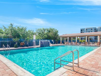 Photo for Spectacular views w/ shared pools, hot tub & gym - across from the beach!
